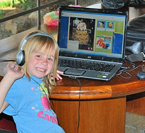Kid enjoying free wifi at KQ Ranch Resort RV camping